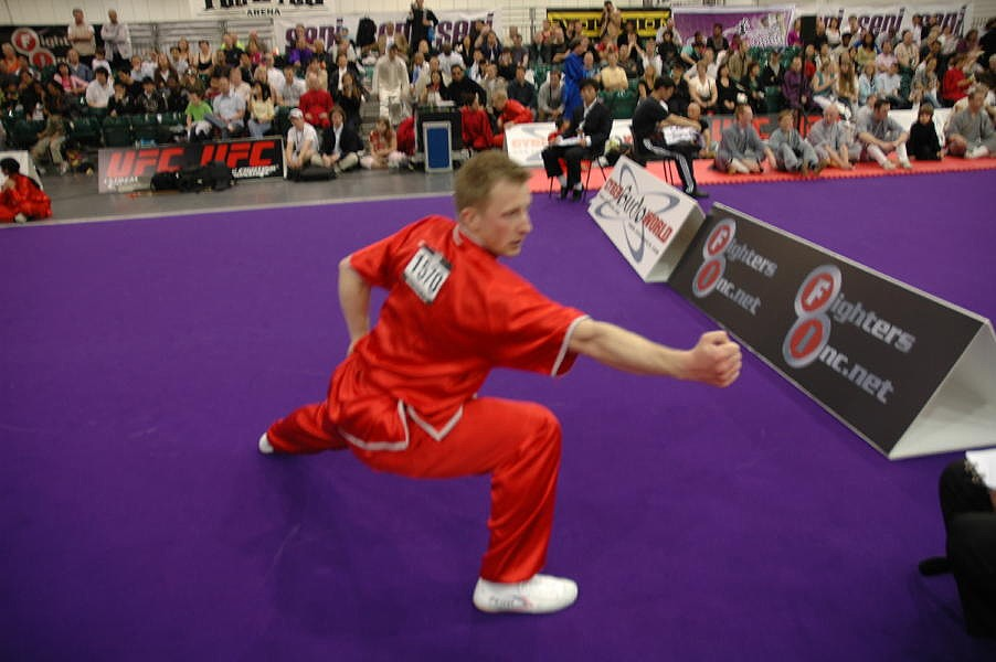 a man in action in red